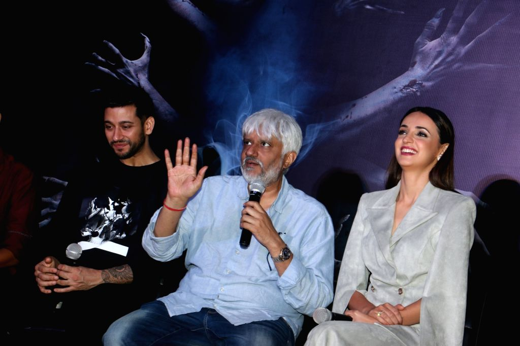"""Director Vikram Bhatt accompanied by actors Shivam Bhaargava and Sanaya Irani, addresses at a press conference during the promotions of their upcoming film """"Ghost"""" in Mumbai on Oct ... - Shivam Bhaargava and Sanaya Irani"""