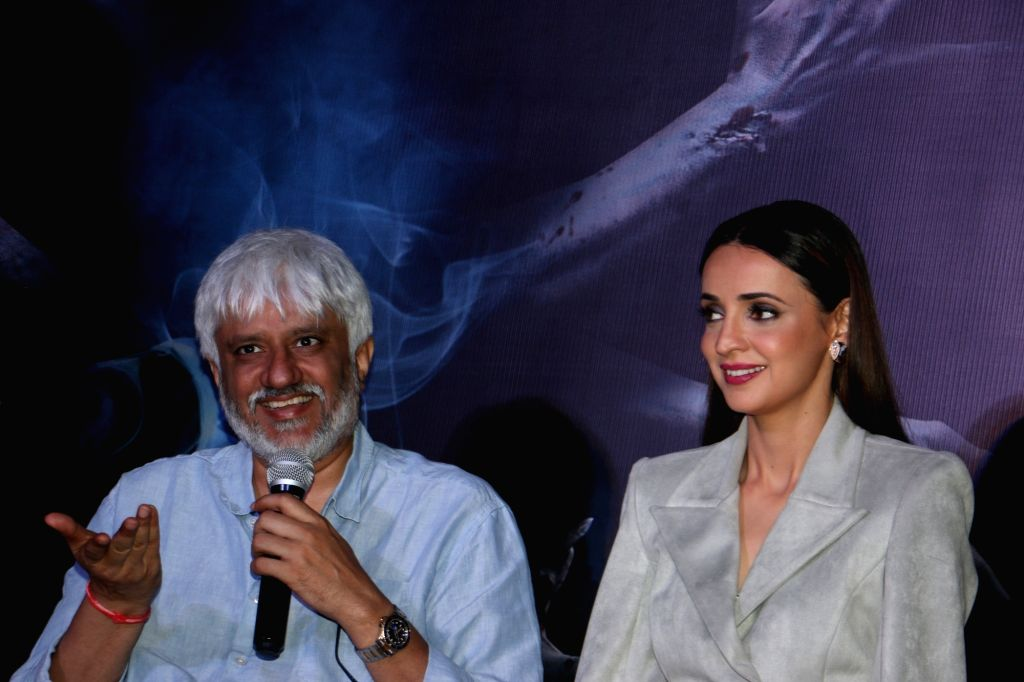 """Director Vikram Bhatt accompanied by actress Sanaya Irani, addresses at a press conference during the promotions of their upcoming film """"Ghost"""" in Mumbai on Oct 15, 2019. - Sanaya Irani"""