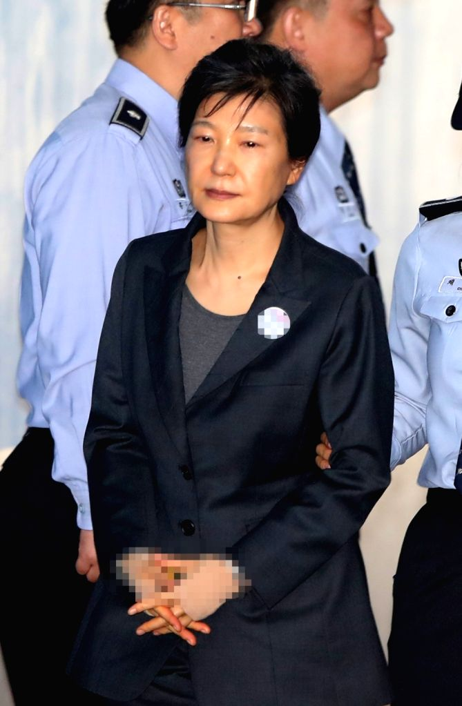 Disgraced former President Park Geun-hye arrives at a Seoul court on Oct. 10, 2017, to attend a hearing on the extension of her detention, which will end at midnight on Oct. 16. Park has been ...