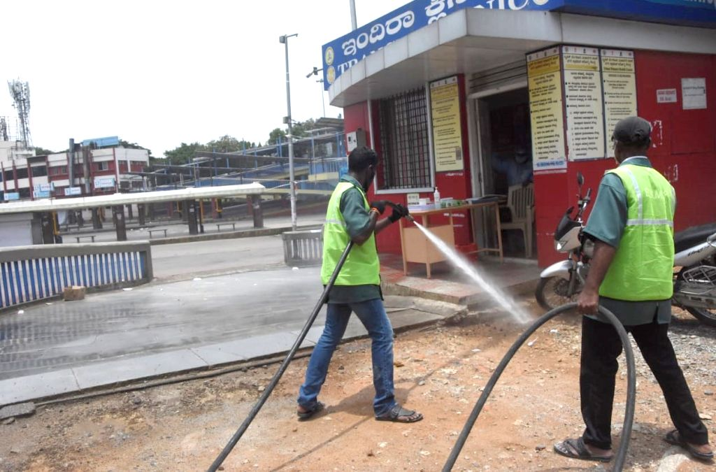 Disinfectants being sprayed at Majestic bus stand during the extended nationwide lockdown imposed to mitigate the spread of coronavirus, in Bengaluru on May 8, 2020.