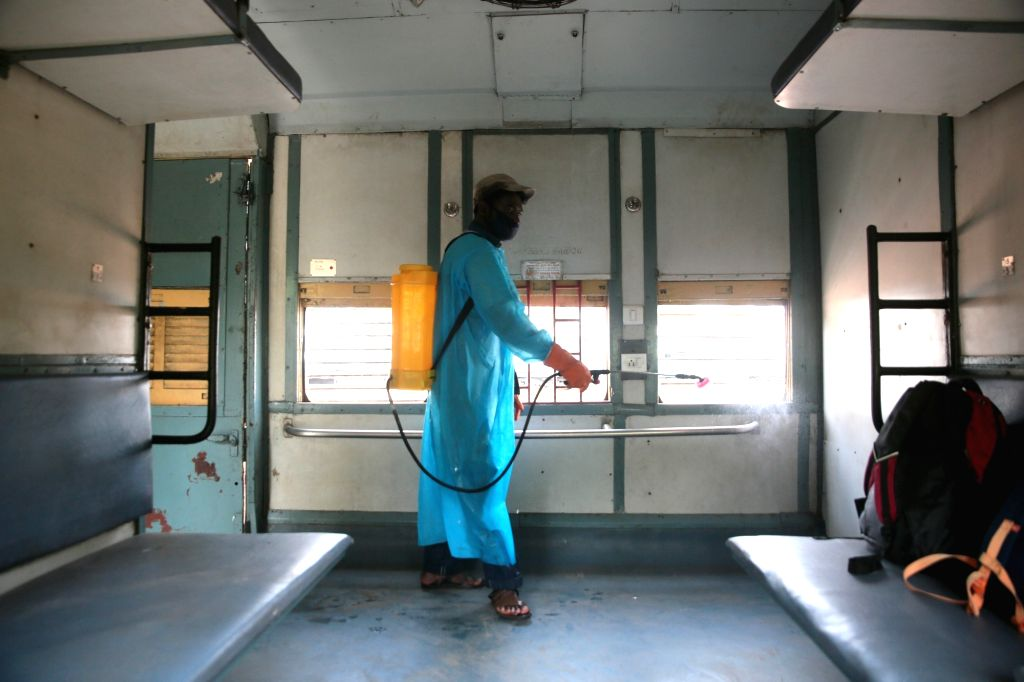 Disinfectants being sprayed inside the coaches of a Shramik Special train for the migrant workers to reach their native place in Uttar Pradesh at Chikkanbanavara railway, in Bengaluru on ...