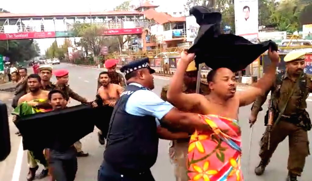 Dispur: Police takes away five men who were staging a nude protest in front of the state secretariat against the Citizenship (Amendment) Bill in Assam's Dispur, on Feb 9, 2019. The incident took place prior to Prime Minister Narendra Modi's public ra - Narendra Modi