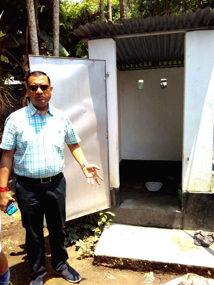 District Collector of Sivasagar Virendra Mittal during a visit with the media persons at the newly constructed  toilets in Lakwa block.