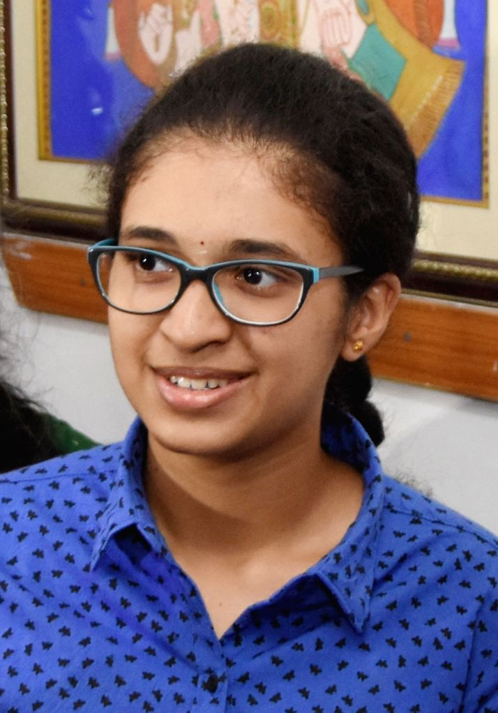 Divya K, the second rank holder of Karnataka 2nd Pre-University Course (PUC) exams 2019 shows victory sign, in Bengaluru, on April 15, 2019.