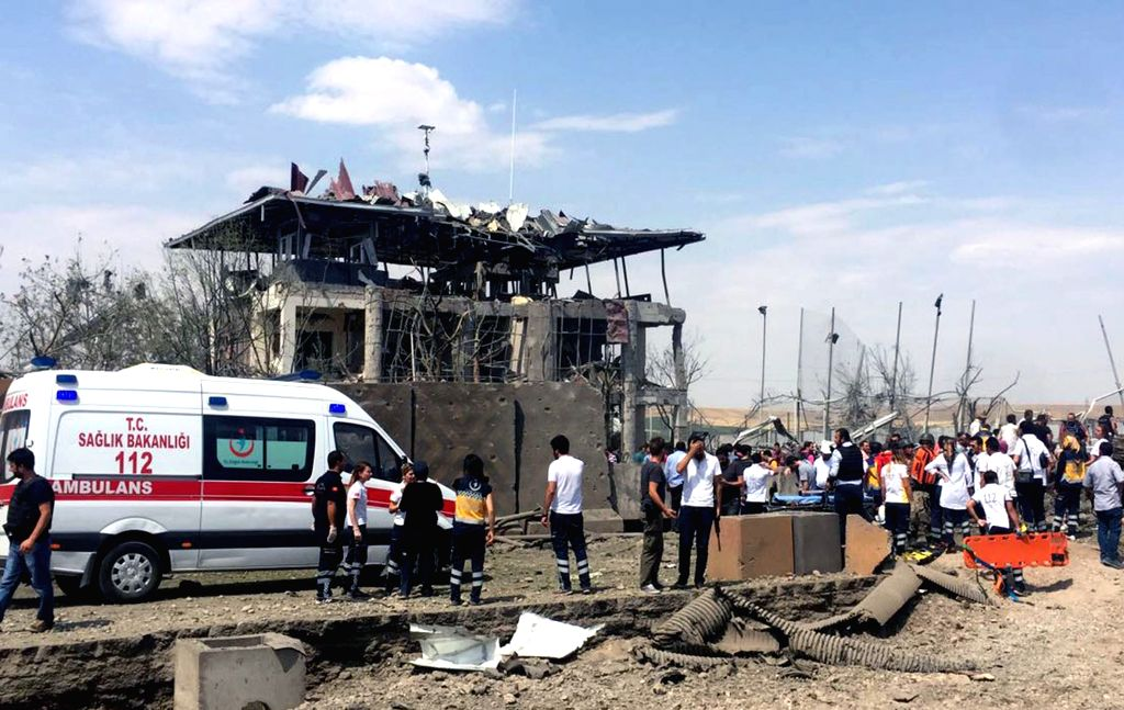 DIYARBAKIR, Aug. 15, 2016 - An ambulance arrives at the site of blast near a traffic police station in Turkey's southeastern province of Diyarbakir, Aug. 15, 2016. Two police officers and one ...