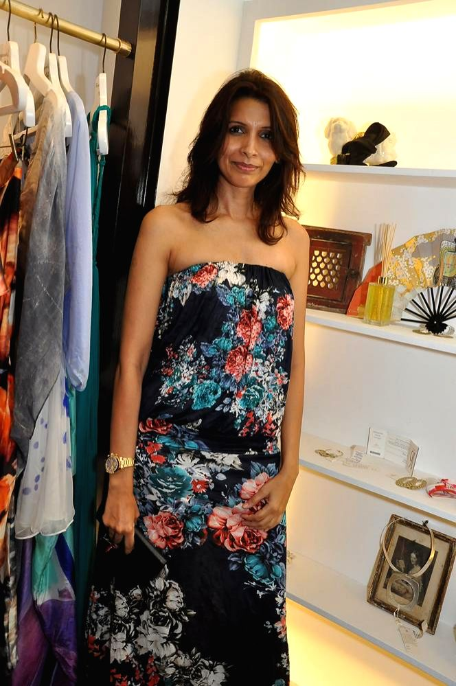 DJ Megha Kawale during the launch of Turquoise & Gold store in Mumbai on April 16, 2014.