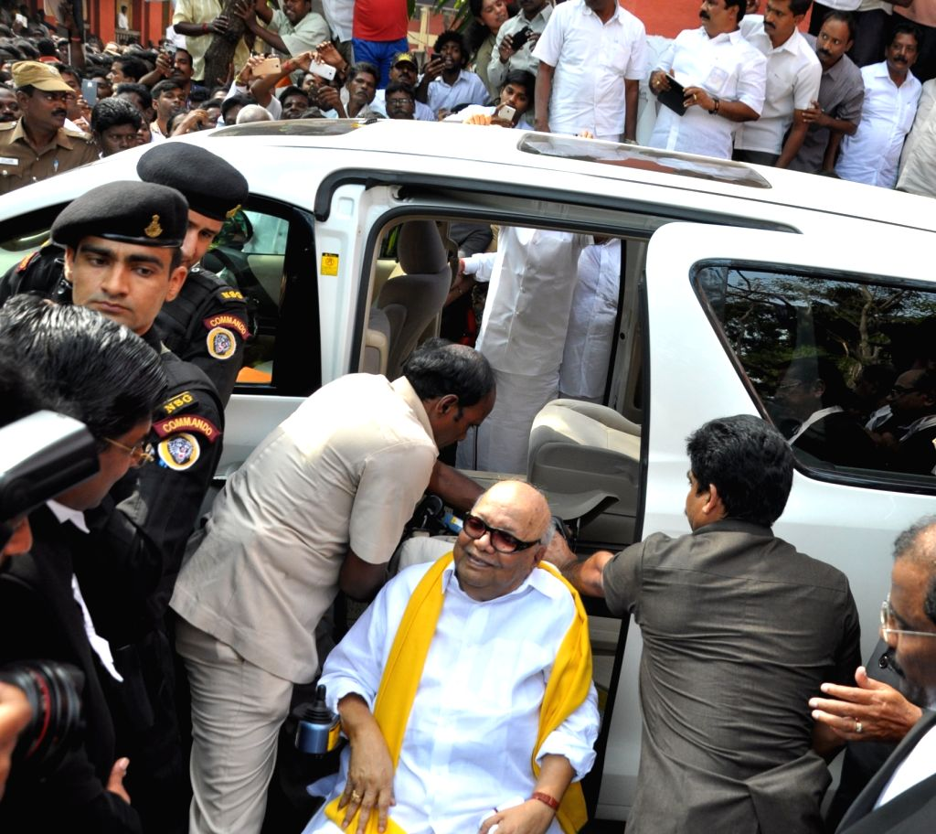 DMK chief M Karunanidhi arrives to appear before a Chennai court in connection with a criminal defamation case filed by the Tamil Nadu government in Chennai, on Jan 18, 2016.