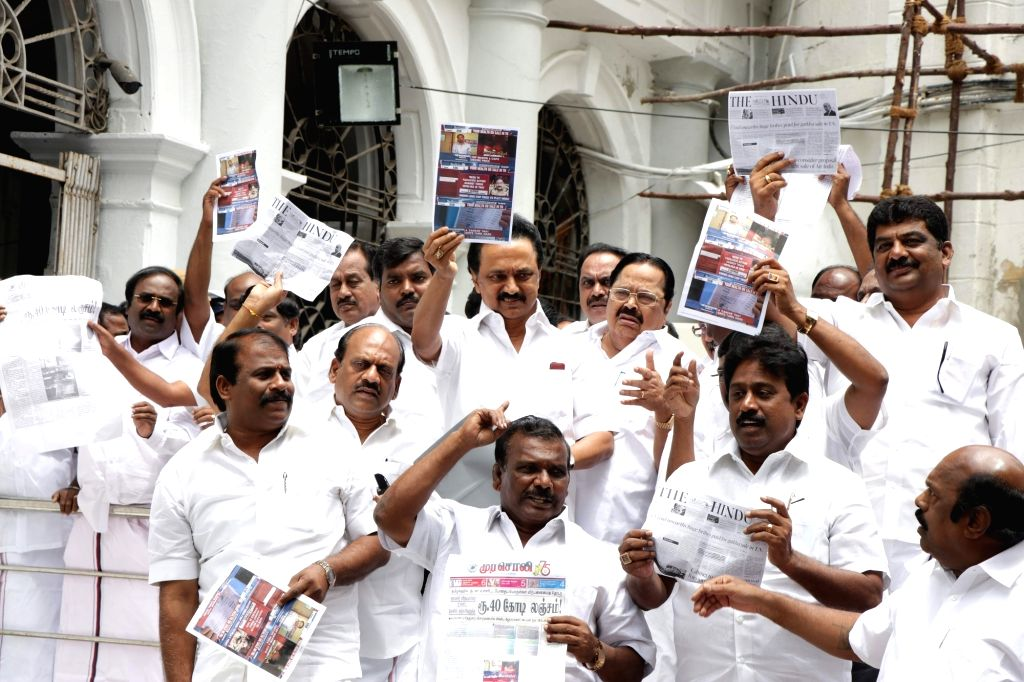 DMK members led by MK Stalin walk out of the Tamil Nadu assembly to protest against the Speaker's decision to disallow a discussion on the alleged bribes paid to a minister and police ...