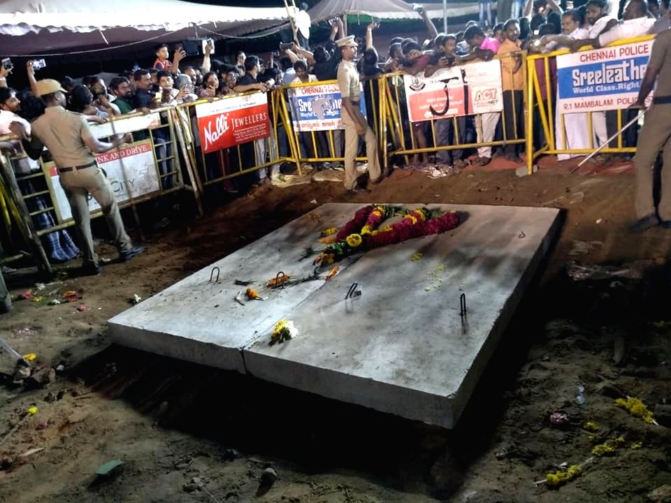 DMK patriarch and former Tamil Nadu Chief Minister M. Karunanidhi laid to rest on the Marina beachfront at Anna Memorial, in Chennai on Aug 8, 2018. Karunanidhi was buried beside his mentor ... - M. Karunanidhi