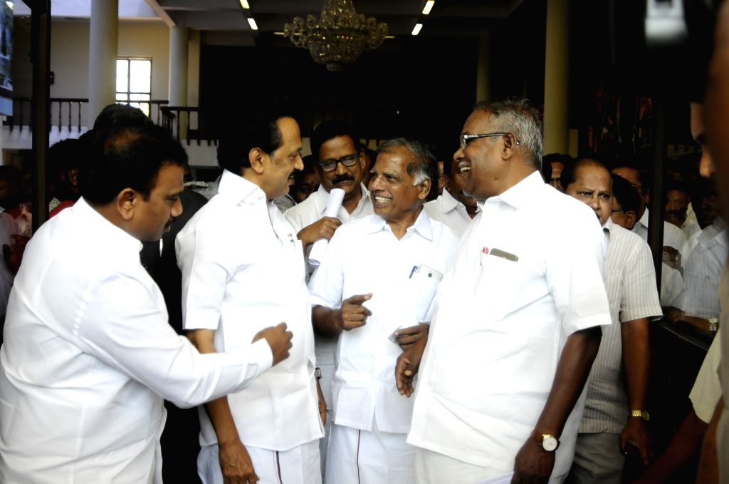 DMK President M.K. Stalin in a conversation with other leaders of the party during a programme where the list of Lok Sabha constituencies from where the party and its allies would field ...