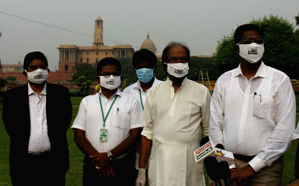 DMK Rajya Sabha MP Trichy Siva accompanied by party legislators, talks to the media personnel outside Parliament on the first day of the Monsoon Session, in New Delhi on Sep 14, 2020.