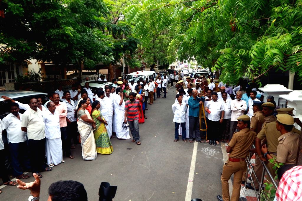 DMK supporters outside DMK President M. Karunanidhi's Gopalapuram residence, in Chennai, on July 27, 2018. M. Karunanidhi (94) is suffering from urinary tract infection and is being treated ...