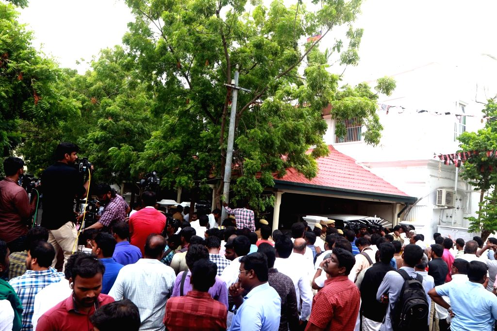 DMK supporters outside party President M. Karunanidhi at his Gopalapuram residence, in Chennai, on July 27, 2018. M. Karunanidhi (94) is suffering from urinary tract infection and is being ...