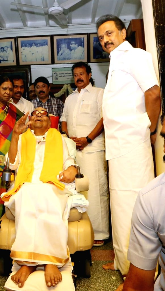 DMK supremo M Karunanidhi and his son and DMK working president MK Stalin interact with supporters on his birthday in Chennai, on June 3, 2018.