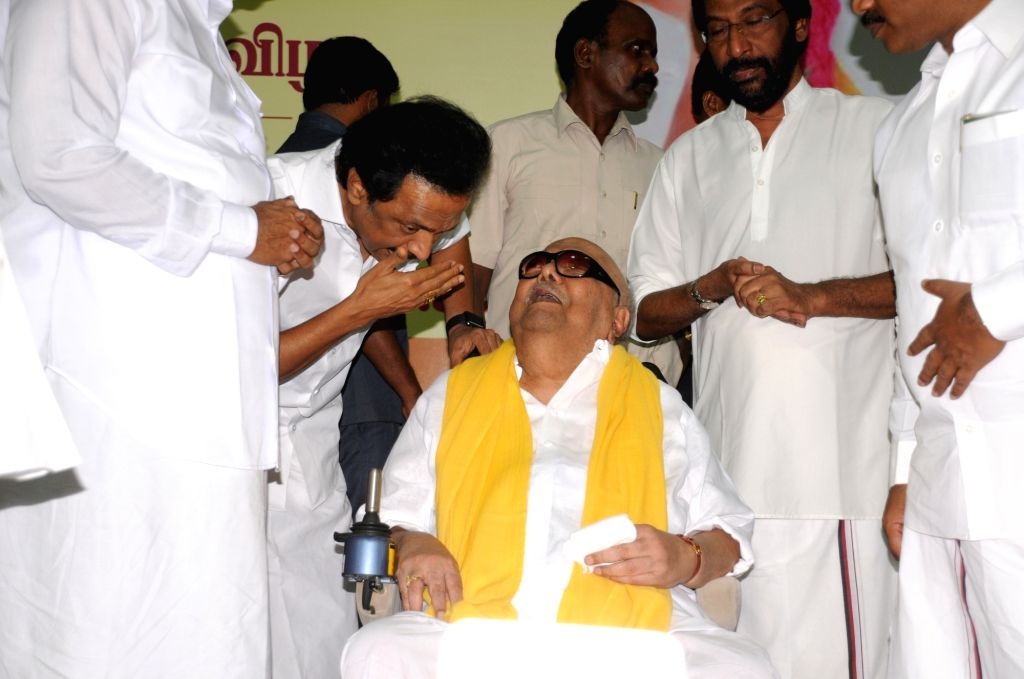 DMK supremo  M. Karunanidhi with party treasurer and his son Stalin during a programme organised to celebrate his birthday in Chennai, on June 3, 2016.