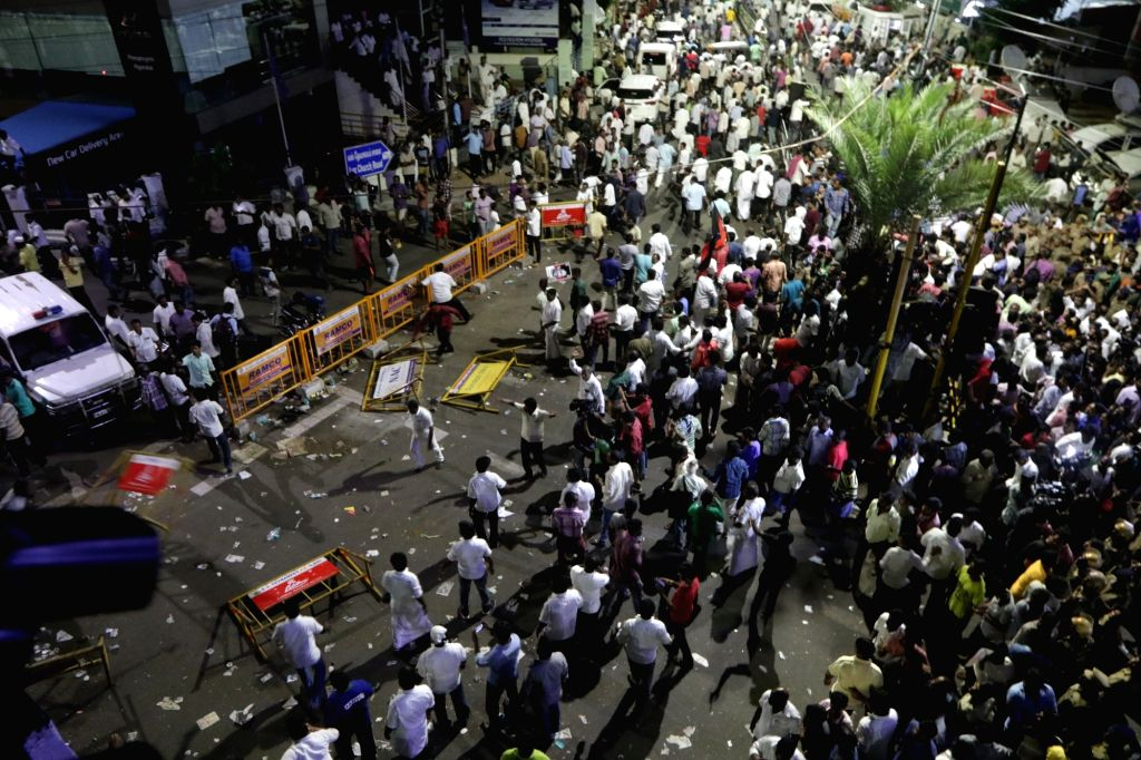 DMK workers resort to violence after Tamil Nadu government declined party's request to allot space for burying the mortal remains of former Chief Minister M. Karunanidhi near party founder ... - M. Karunanidhi