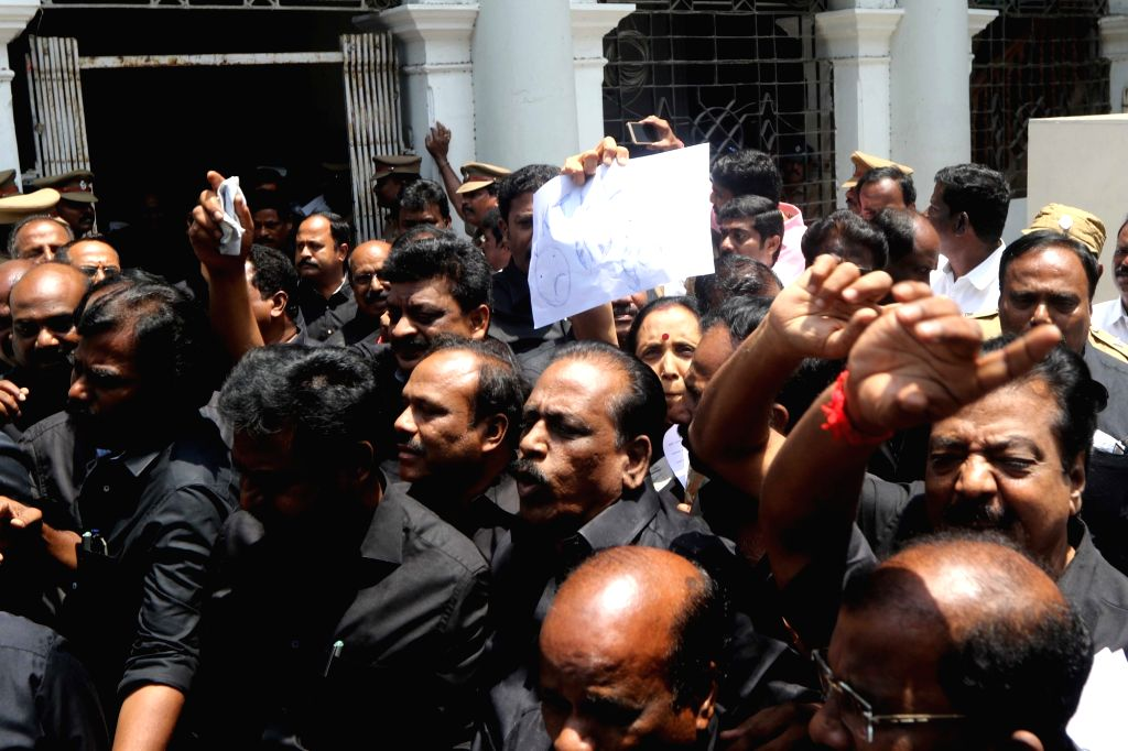 DMK workers wearing black clothes stage a demonstration against the death of 13 people who lost their lives in police firing during anti-Sterlite protests, at the state assembly in Chennai ...