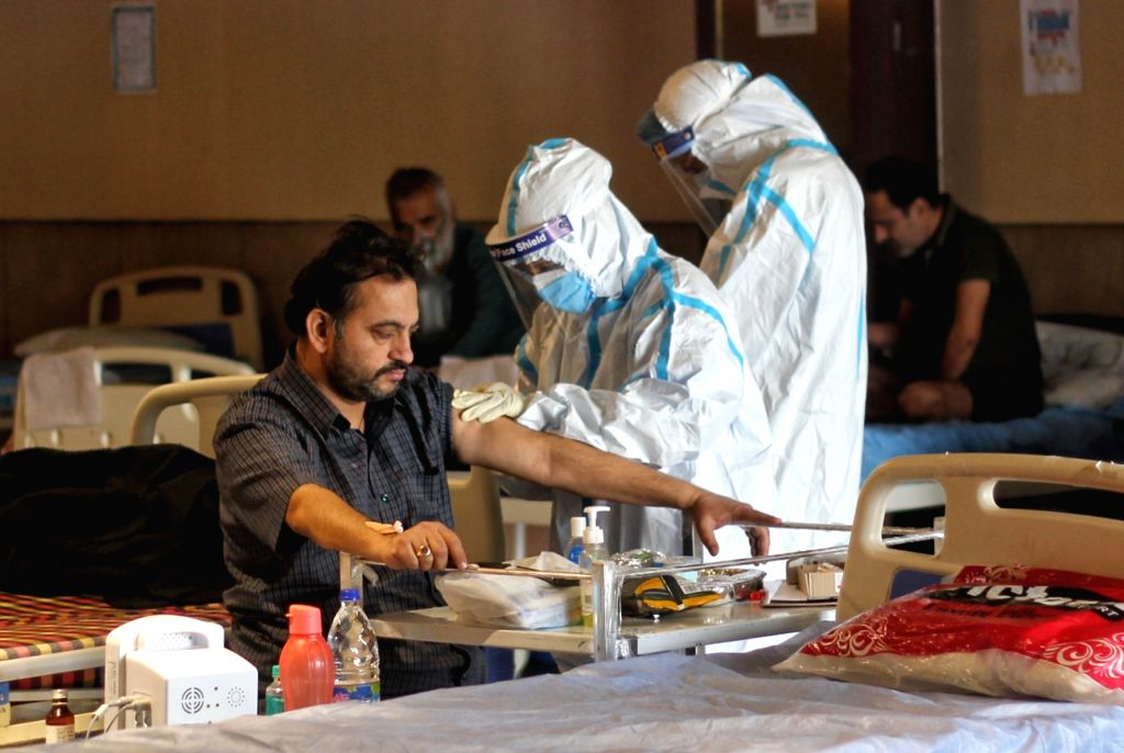 Doctor for You Medical staff in PPE coveralls attend to patients housed in the Shehnai Banquet Hall Covid-19 care centre attached to LNJP Hospital in New Delhi on Wednesday, May 12, 2021.