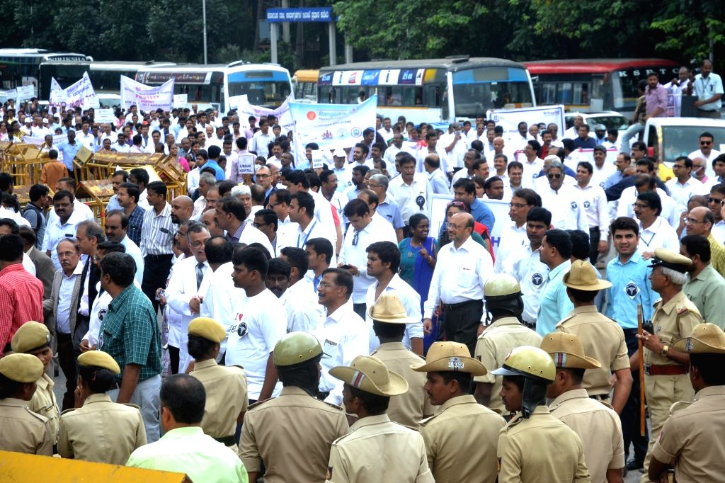 Doctors and healthcare professionals from all over Karnataka stage a demonstration against proposed amendments to the Karnataka Private Medical Establishments (KPME) Act, in Bengaluru on ...