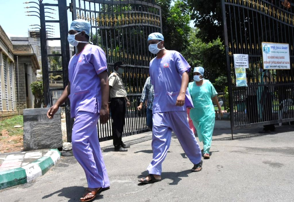 Doctors and nurses from Vanivilas hospital coming out from the hospital premises to protest against Vanivilas administration for not providing Personal Protective Equipment (PPE) kits, in ...