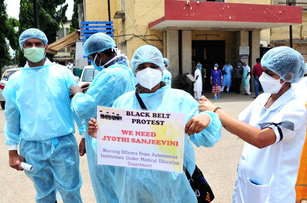 Doctors and nurses of Bowring and Lady Curzon Hospital protest over their various demands, in Bengaluru on Aug 1, 2020.