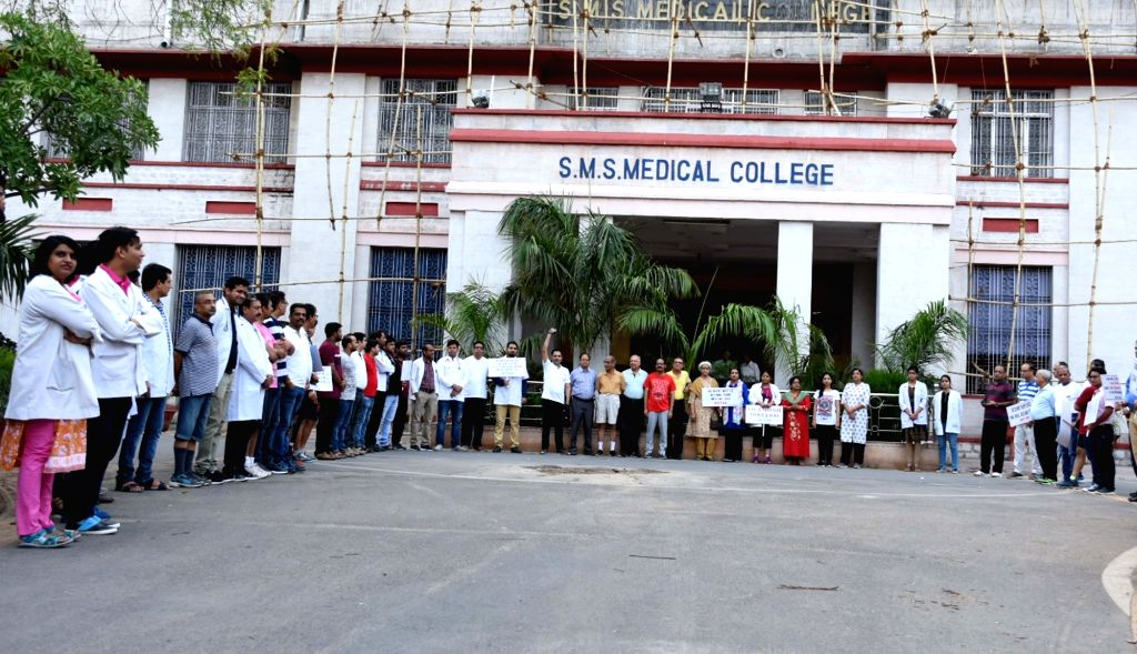 Doctors continued strike for the sixth consecutive day, staging a demonstration against the assault on doctors at Kolkata's NRS Medical College and Hospital; in Jaipur, on June 16, 2019.