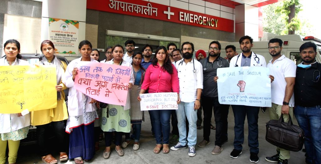 Doctors of a Delhi hospital stage a demonstration against the assault on doctors at NRS Medical College and Hospital in Kolkata; in New Delhi on June 15, 2019.