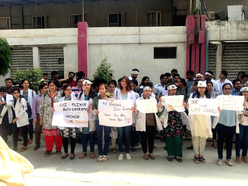 Doctors of ESI-PGIMSR Hospital, Basaidarapur stage a demonstration against the assault on doctors at NRS Medical College and Hospital in Kolkata; in New Delhi on June 15, 2019.