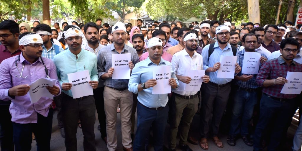Doctors of National Institute of Management Solutions (NIMS) wear bandages on their heads as they stage a demonstration against doctors who were assaulted in Kolkata and press for adequate ...