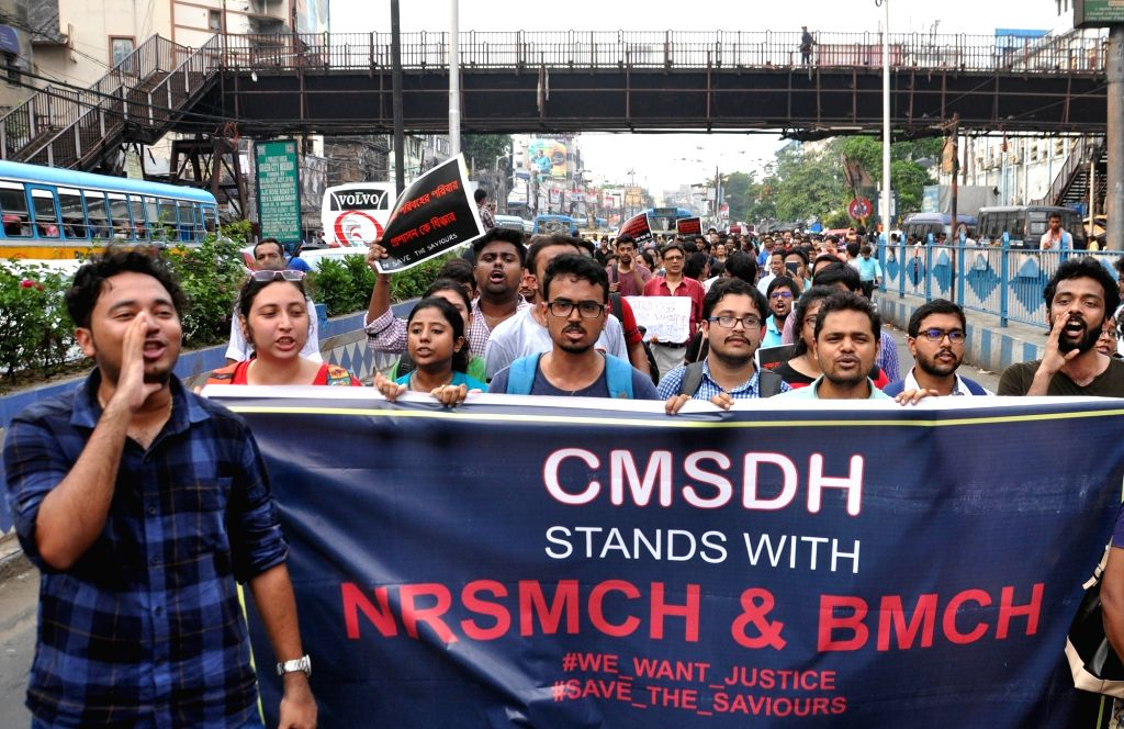Doctors participate in a protest rally to express solidarity with the junior doctors at the NRS Medical College and Hospital agitating against the brutal attack on two junior doctors against ...