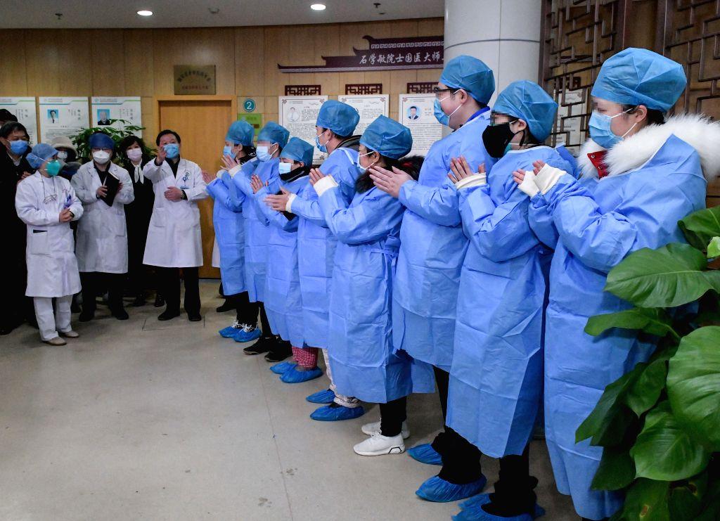 Doctors speak with cured novel coronavirus pneumonia patients in Wuhan, central China's Hubei Province, Feb. 6, 2020. A total of 23 novel coronavirus pneumonia ...