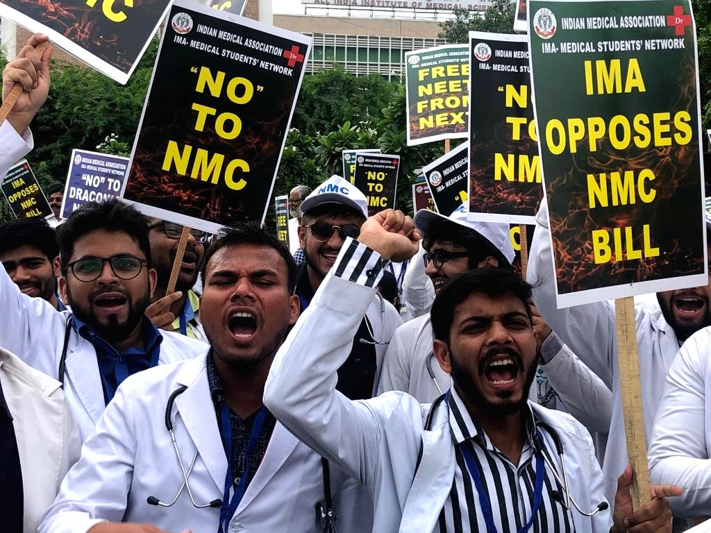 Doctors stage a demonstration against the National Medical Commission (NMC) Bill alleging that the bill will only give a boost to quacks; at All India Institute of Medical Sciences (AIIMS) ...