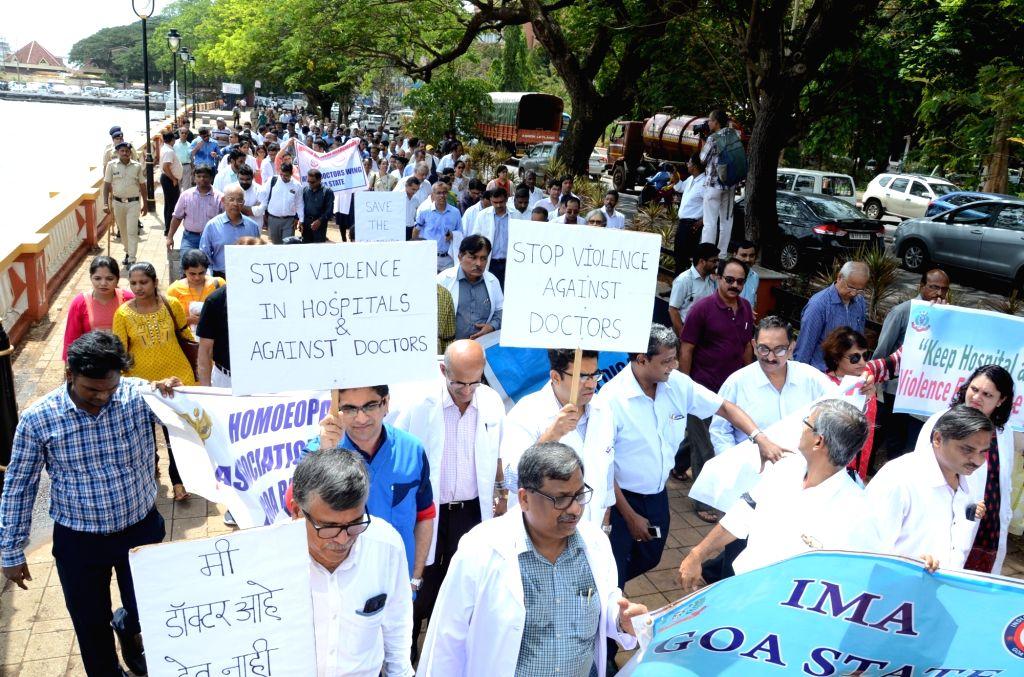 Doctors stage a demonstration against violence on doctors in Panaji on June 17, 2019.