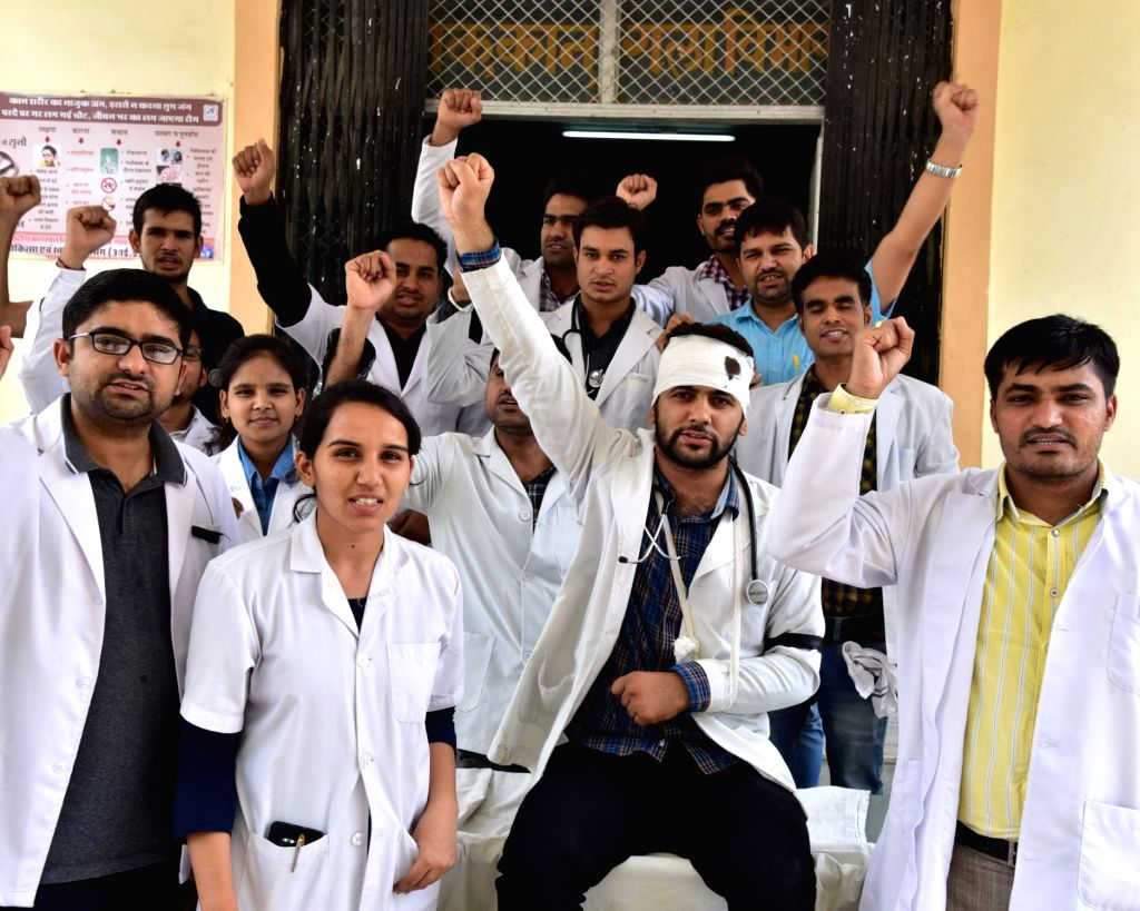 Doctors stage a demonstration during one-day token strike called by the Indian Medical Association (IMA) in support of the junior doctors??? stir of NRS Medical College, Kolkata, who were ...