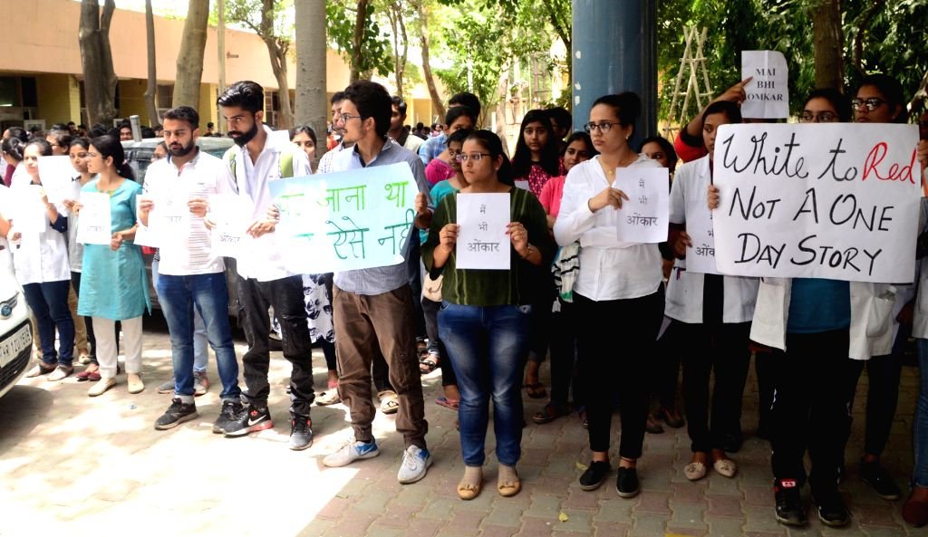 Doctors stage a demonstration to protest against the brutal attack on two junior doctors at a Kolkata Hospital; in Rohtak on June 15, 2019.