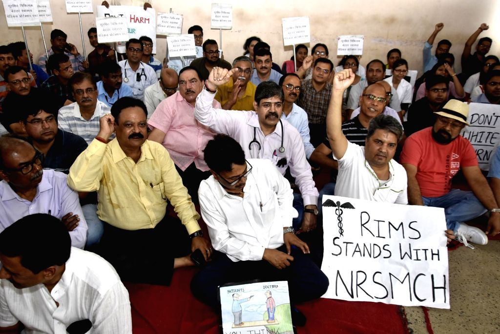 Doctors stage a sit-in demonstration against the assault on doctors at Kolkata's NRS Medical College and Hospital; in Ranchi, on June 17, 2019.