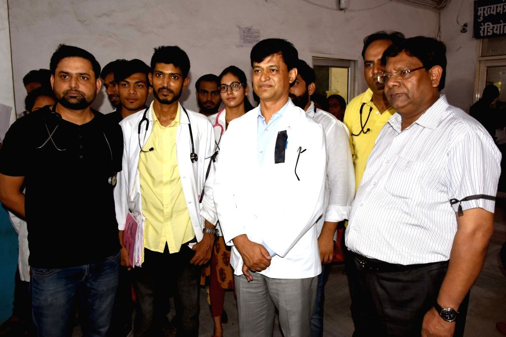 Doctors wear black bands to show solidarity with their colleagues in Kolkata who are protesting against the brutal attack on a doctor at a major hospital; in Jaipur on June 14, 2019.