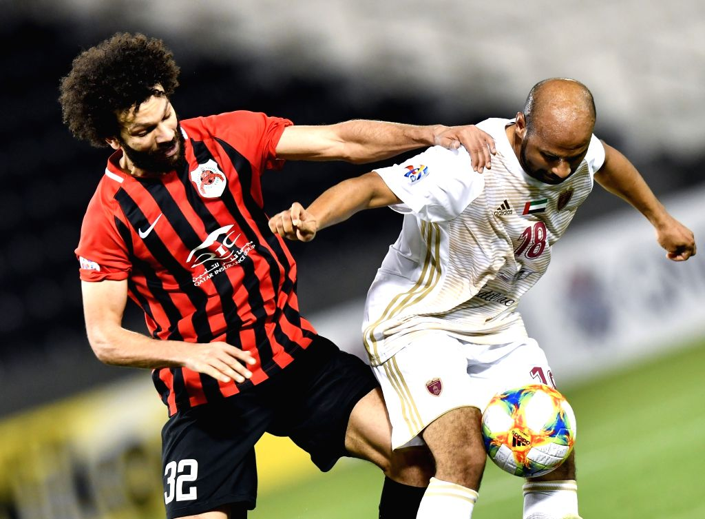 DOHA, April 10, 2019 - Ahmed Ali (R) of Al Wahda FSCC vies with Ahmed El Sayed of Al Rayyan SC during the AFC Asian Champions League group B match between Qatar's Al Rayyan SC and UAE's Al Wahda FSCC ...