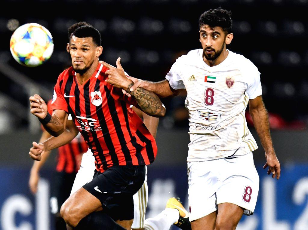 DOHA, April 10, 2019 - Hamdan Al Kamali (R) of Al Wahda FSCC vies with Gelmin Rivas of Al Rayyan SC during the AFC Asian Champions League group B match between Qatar's Al Rayyan SC and UAE's Al Wahda ...