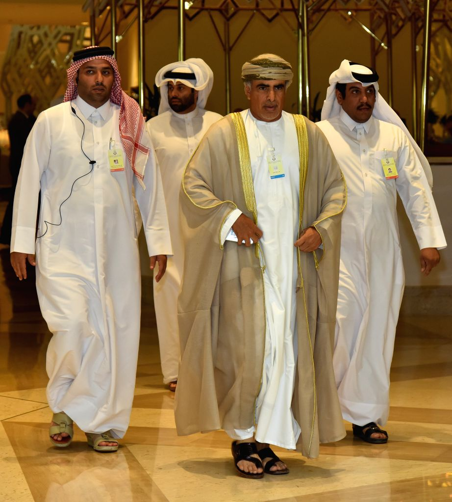 DOHA, April 18, 2016 - Oman's Minister of Oil and Gas Mohammed bin Hamad Al Rumhy (Front) arrives for the Organization of Petroleum Exporting Countries (OPEC) and non-OPEC oil producers meeting at ...
