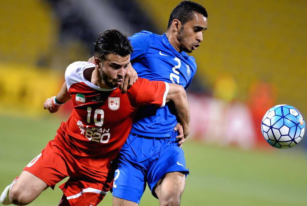 DOHA, April 20, 2016 - Mohammed Alburayk (R) of Al Hilal vies with Soroush Rafiei of Tractor Sazi Tabriz during the AFC Asian Champions League Group C football match between Iran's Tractor Sazi ... - Sazi Tabriz