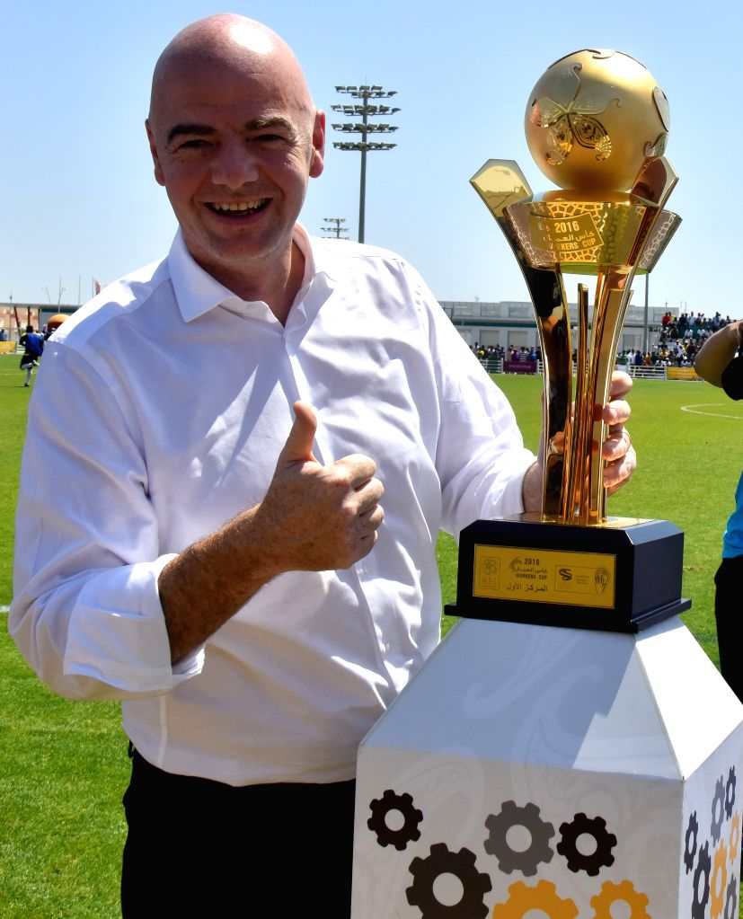 DOHA, April 22, 2016 - FIFA President Gianni Infantino holds the 'Workers Cup Qatar 2016' trophy at the Qatar Football Association Technical committee ground before the joint press conference for ...