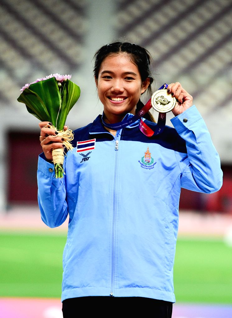 DOHA, April 24, 2019 - Gold medalist Parinya Chuaimaroeng of Thailand poses for photos during the awarding ceremony of women's triple jump event at the 23rd Asian Athletics Championships at Khalifa ...