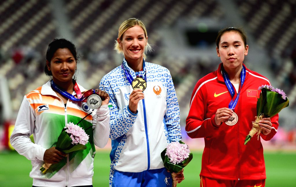 DOHA, April 24, 2019 - Gold medalist Uzbekistan's Ekaterina Vornina (C), silver medalist India's Purnima Hembram (L) and bronze medalist China's Wang Qingling pose for photos during the awarding ...