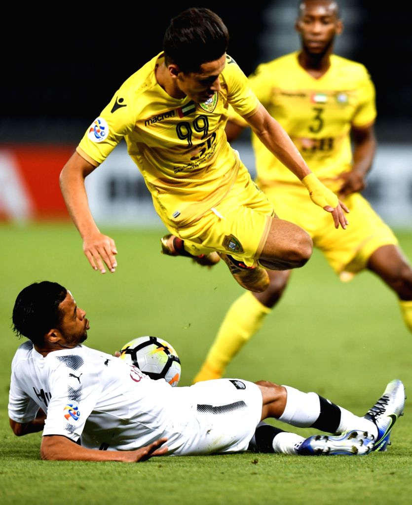 DOHA, April 3, 2018 - Ali Saleh (Top) of Al Wasl FC is tackled by Hamid Ismaeil of Al Sadd vies with during the AFC Champions League Group C soccer match between Qatar's Al Sadd SC and Al Wasl FC of ...