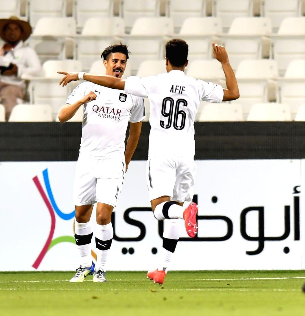 DOHA, April 3, 2018 - Baghdad Bounedjah (L) of Al Sadd celebrates during the AFC Champions League Group C soccer match between Qatar's Al Sadd SC and Al Wasl FC of the United Arab Emirates (UAE) at ...