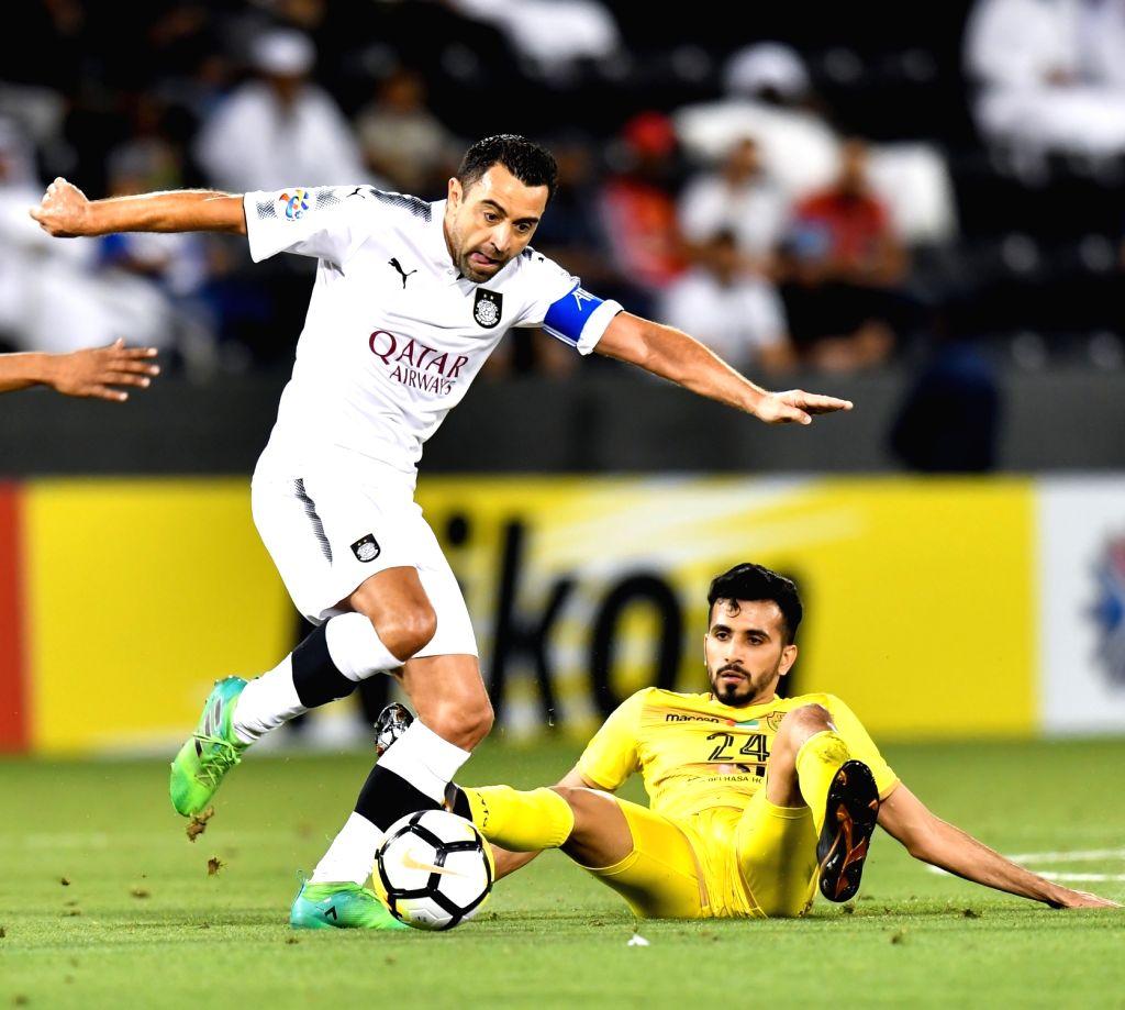 DOHA, April 3, 2018 - Xavi (L) of Al Sadd vies with Hamad Al-Bloushi of Al Wasl FC during the AFC Champions League Group C soccer match between Qatar's Al Sadd SC and Al Wasl FC of the United Arab ...