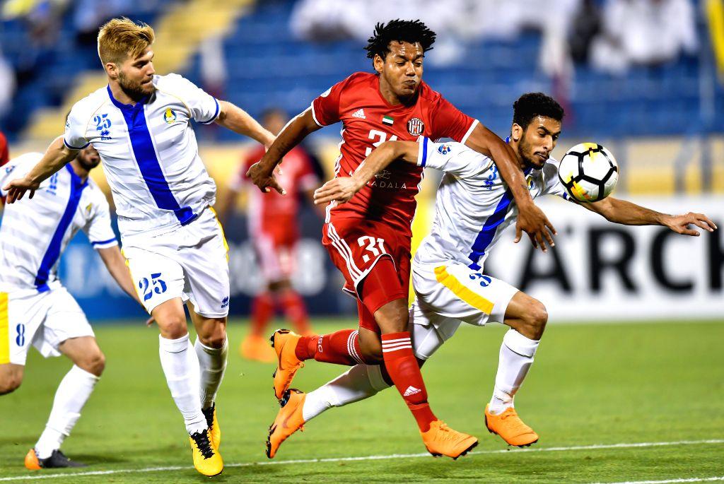 DOHA, April 4, 2018 - Diogo Amado (L) and Tameem Al Muhaza (R) of Al Gharafa vie with Romarinho (C) of Al Jazira FSC during the AFC Champions League Group A soccer match between Qatar's Al Gharafa ...