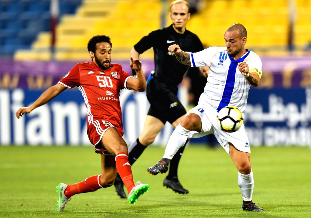 DOHA, April 4, 2018 - Mohamed Jamal (L) of Al Jazira FSC vies with Wesley Sneijder (R) of Al Gharafa during the AFC Champions League Group A soccer match between Qatar's Al Gharafa and Al Jazira FSC ...