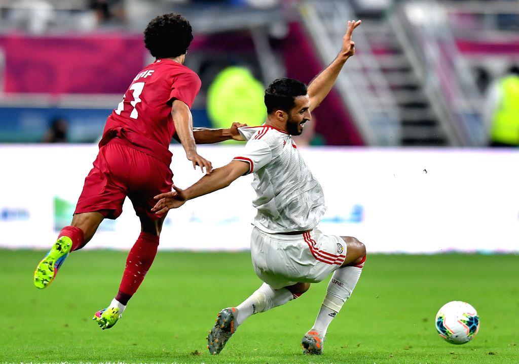 DOHA, Dec. 3, 2019 - Akram Afif of Qatar (L) of Qatar competes during the 24th Arabian Gulf Cup 2019 Group A football match between Qatar and United Arab Emirates (UAE) at the Khalifa International ...